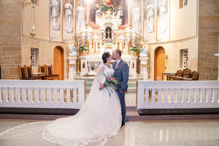Bride and Groom ceremony pictures at beautiful catholic church - Emma Males Photography