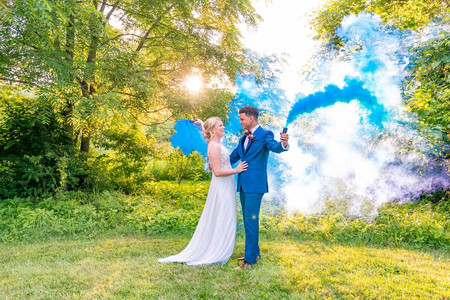 Couple with blue smoke bomb with Styled Shoot by Emma Males Photography at The Vineyard Gardens in Indianapolis Indiana