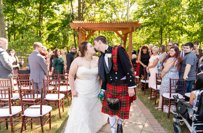 Indianapolis Wedding Photographer - bride and groom kiss walking down the aisle