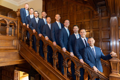 groomsmen on stairs at laurel hall