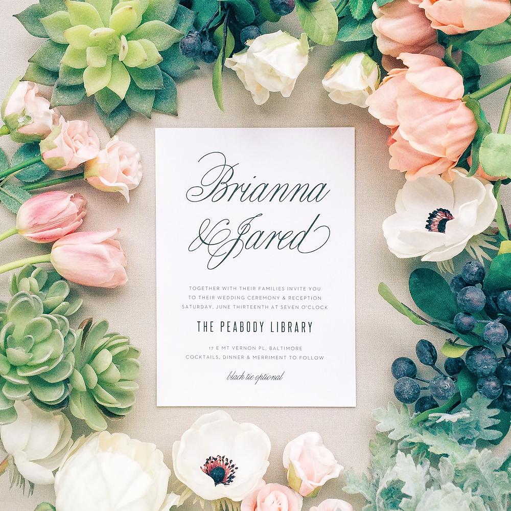 flowers with elegant wedding invitation