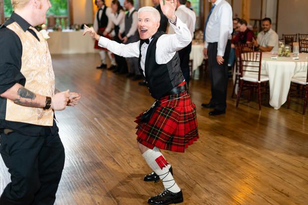 Indianapolis Wedding Photographer - grooms dad dancing at receptions