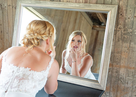 Bride putting on makeup at Styled Shoot by Emma Males Photography at The Vineyard Gardens in Indianapolis Indiana
