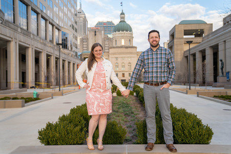 holding hands in front of the Indiana capital building