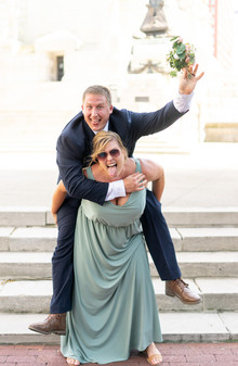 Indianapolis Wedding Photographer Emma Males - groom and bridesmaid on monument circle