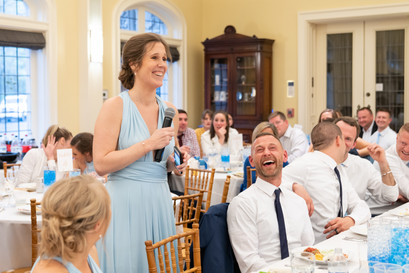 laughing at maid of honor toast