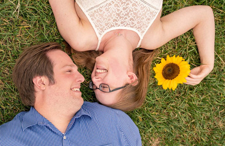 couple laying on ground looking at each other - Indianapolis Wedding Photographer