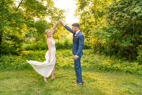 Groom twirling bride at Styled Shoot by Emma Males Photography at The Vineyard Gardens in Indianapolis Indiana