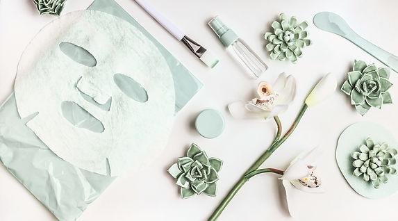 Skin care flat lay with facial sheet mas