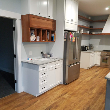 Beautiful shaker cabinetry with cherry accents