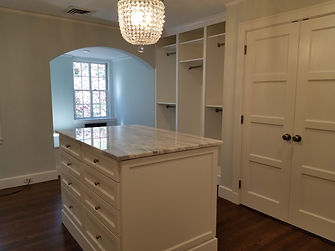 Closet island with double sided drawers