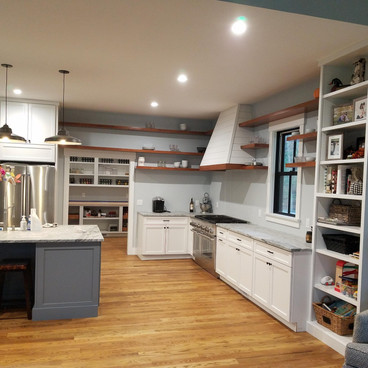 Spacous country kitchen with floating Cherry shelves.