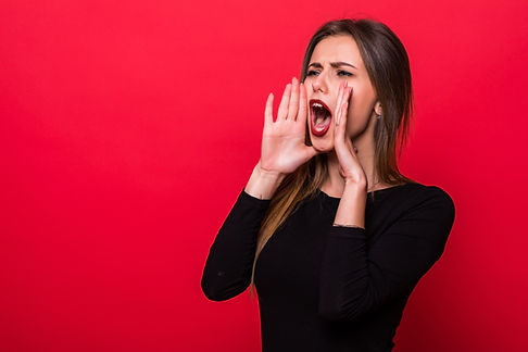 Portrait woman shouting over red backgro