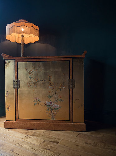 large chinese drinks cabinet covered all over in gold leaf and hand painted decoration