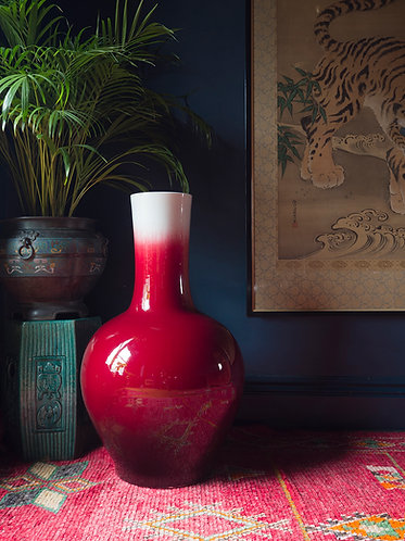 A very large globular form cherry red chinese vase with a mottled surface and fine crackle glaze