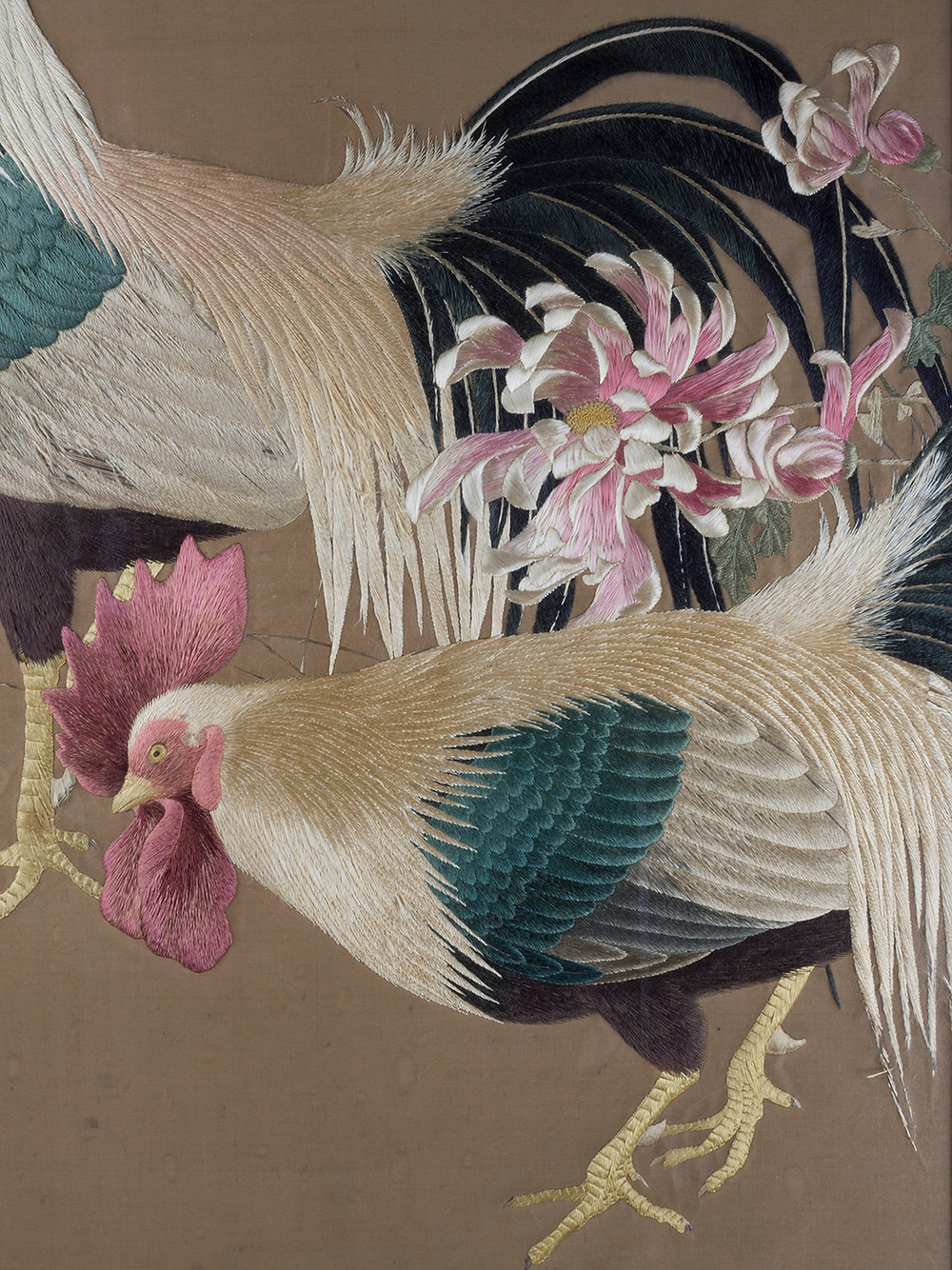 detail from a meiji period embroidery showing the head of a chicken, the fleshy comb and wattle realistically rendered