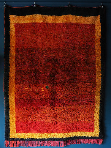 mid century berber rug in reds and oranges with deep pile