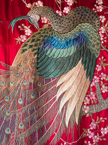 Japanese silk embroidery of peacocks among cherry blossoms on a deep red or carmine ground