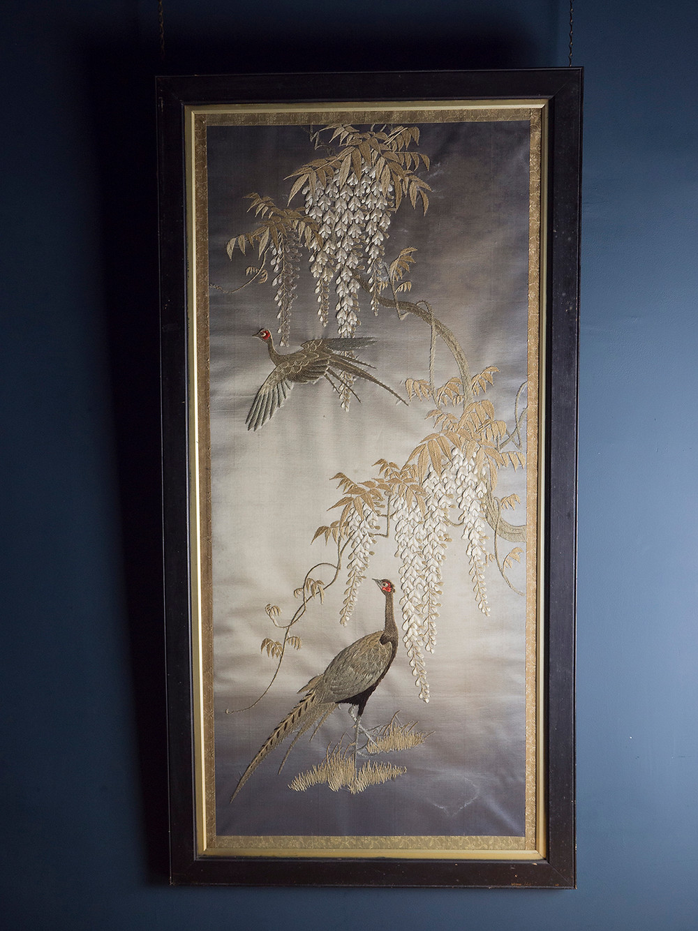 a late meiji period japanese embroidery in it's original frame
