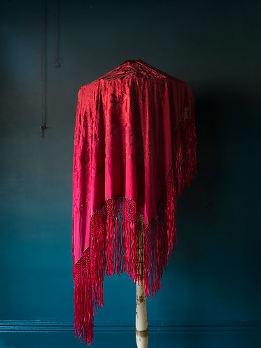 red silk chinese pano shawl draped over a large edwardian lampshade
