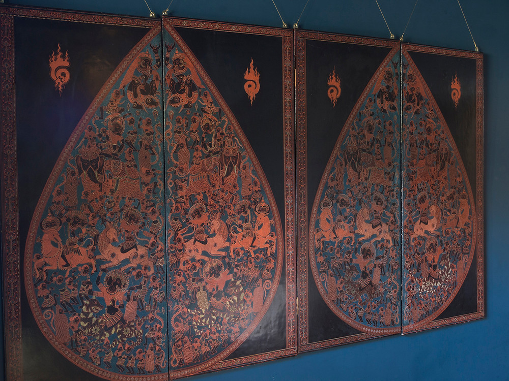 burmese lacquered engraving. The design drawn across four panels in mirrored teardrops filled with scenes from Hindi mythology