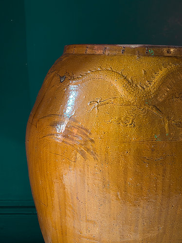 very large mustard yellow floor vase with embossed decoration of dragon and phoenix across the top