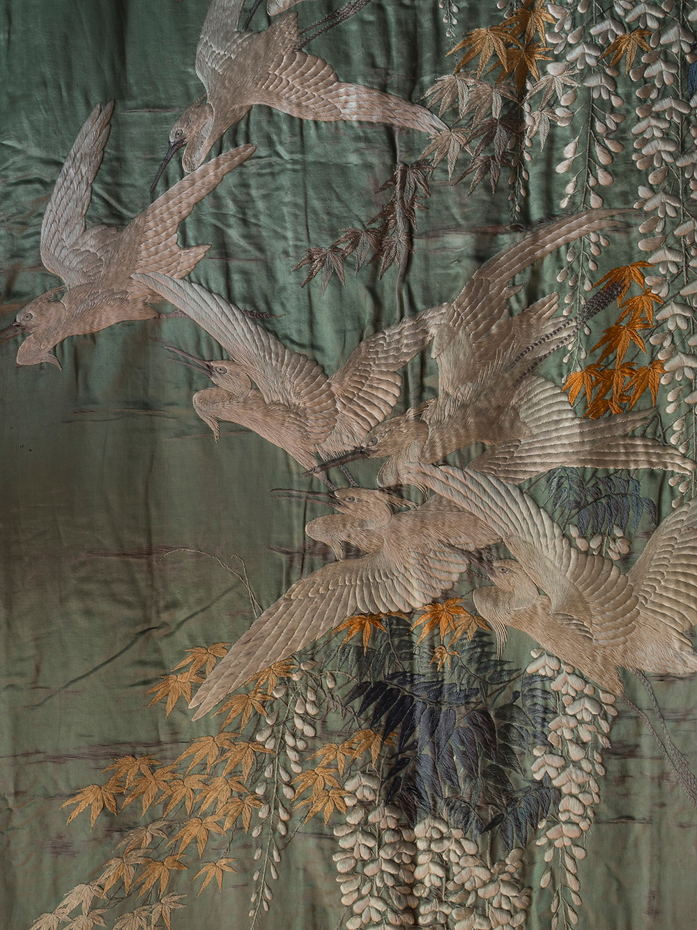 japanese meiji embroidery with seven cranes flying through wisteria