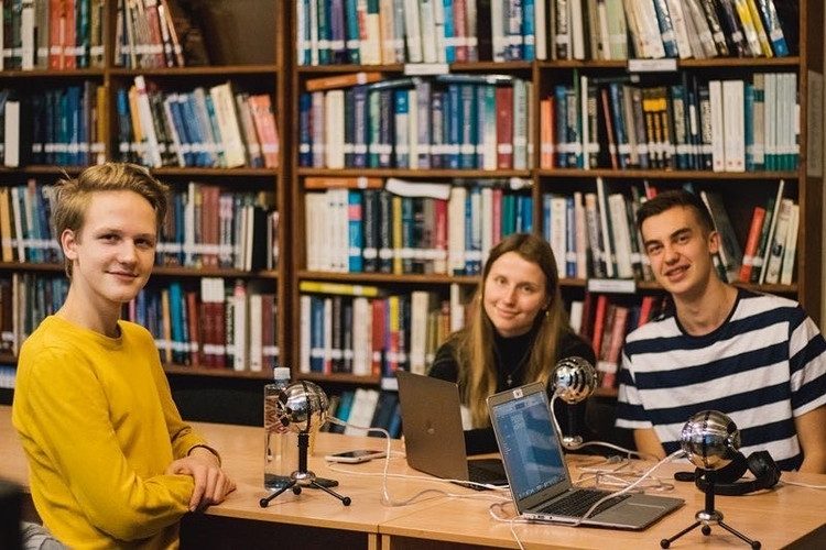 "Two FLEX Latvia alumni recording their podcast series ""Yearwind,"" with another FLEX Latvia alumnus as a guest speaker"