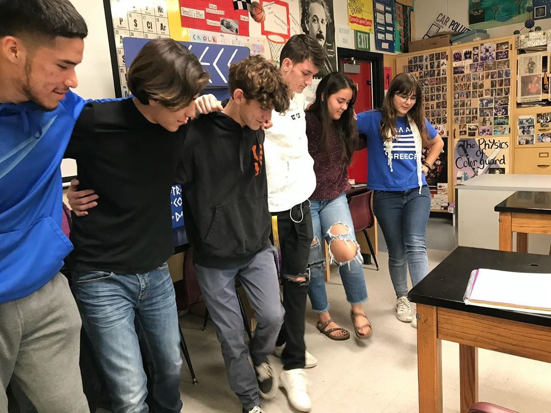 FLEX student teaching a Greek dance to five classmates