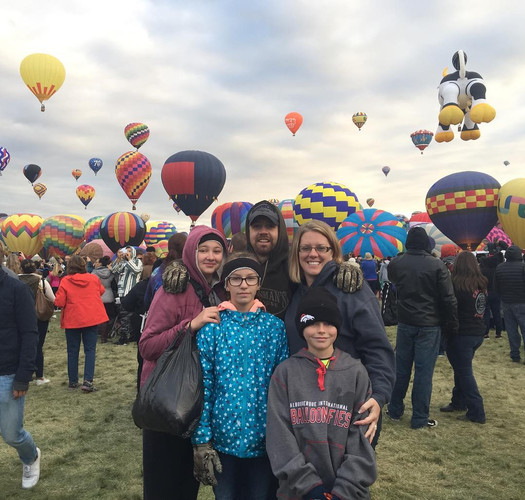 FLEX student with her host family at a hot air balloon festival