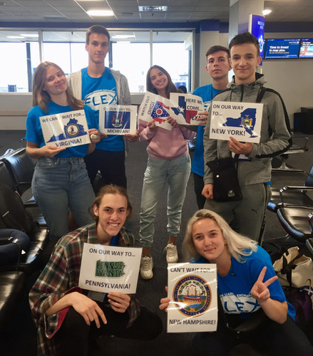 Seven FLEX students holding state cards of their host states