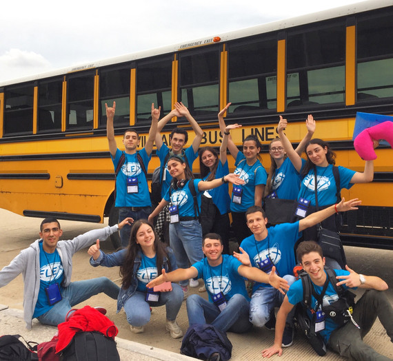 Group of FLEX students in front of yellow school bus