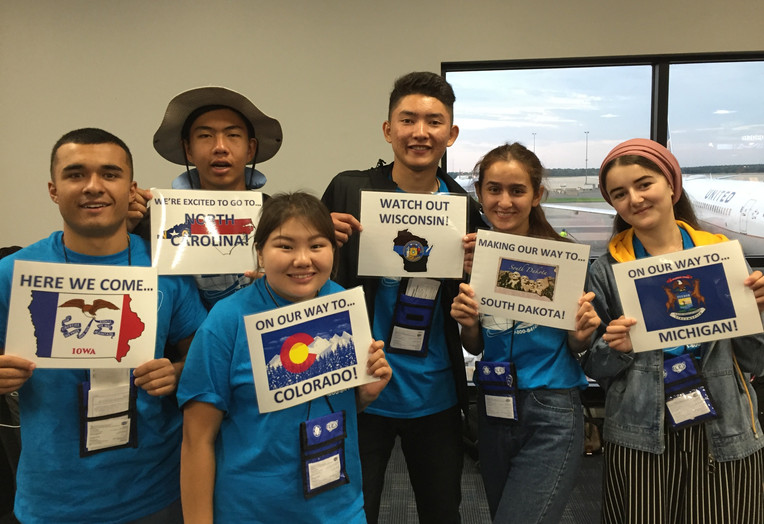 Six FLEX students holding state cards of their host states