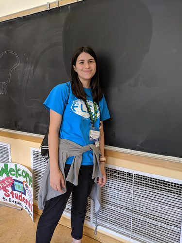 Marija smiling in front of a chalkboard (see her quote on the page below)