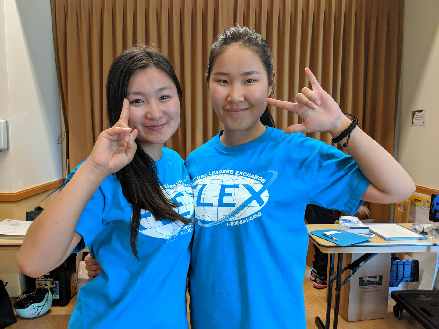 Two FLEX students showing the love and peace hand signs