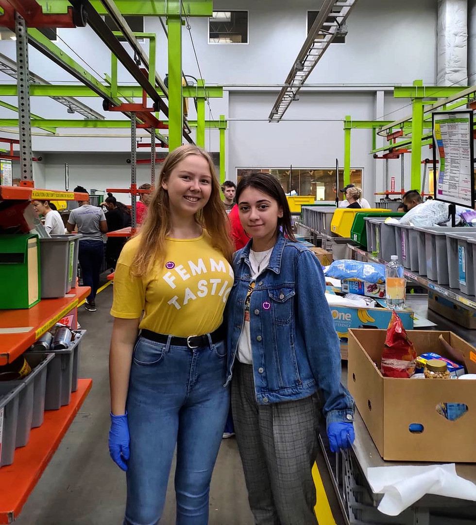 Two FLEX students volunteering in an assembly line
