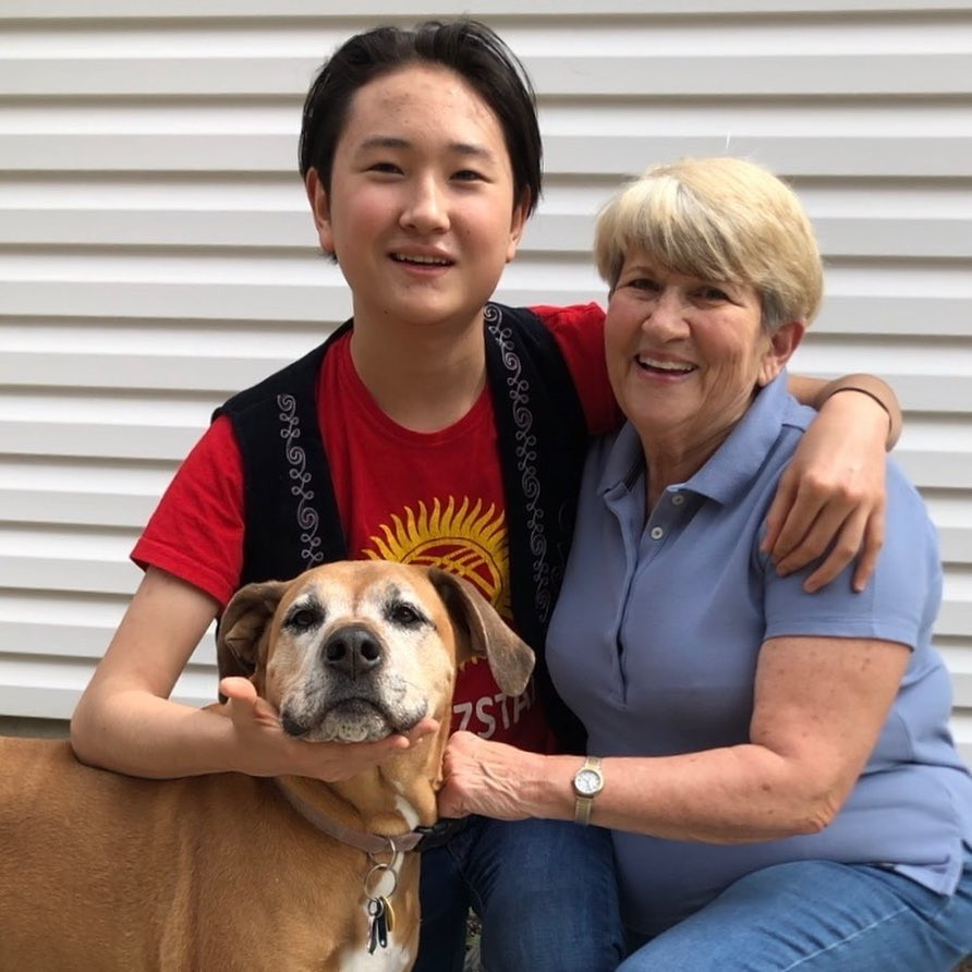 FLEX student with his host mom and dog