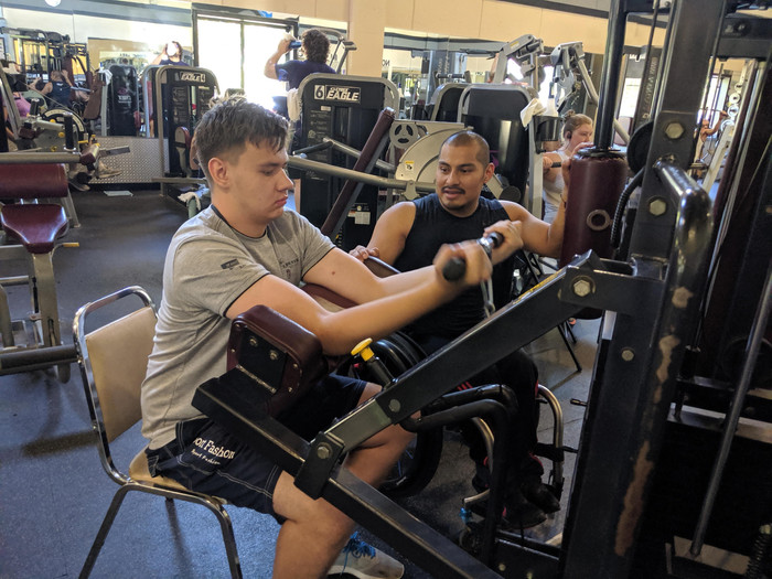 Danil using an arm exercise machine at the gym (see his quote on the page below)