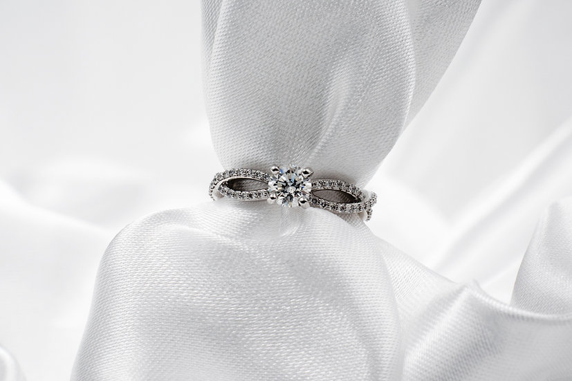 18K White Gold .54ct Center Infinity 1/4cttw Accent Diamond Engagement Ring
