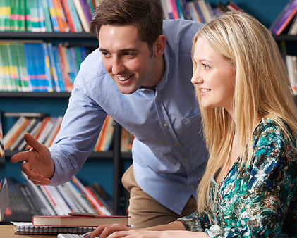 Tutor helping student with online class