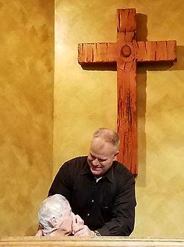 Pastor Ed Performing Baptism sm.jpg
