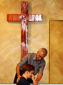 Paster Howard Performing Baptism sm.jpg
