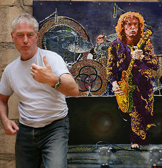Artist Barry Novis with his Jimmy Page painting