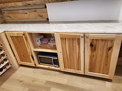 Maple Cabinets In Pantry With Floating Shelves