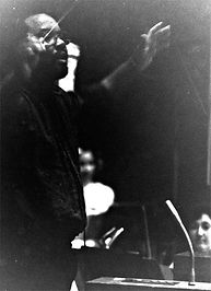 James A. Goins conducting