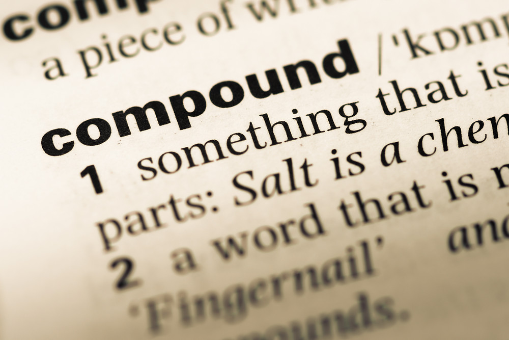 "Close-up of the word ""compound"" in a dictionary entry."
