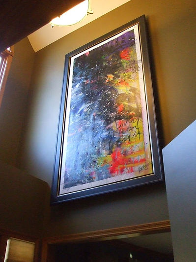 Large picture frame hanging on a high wall