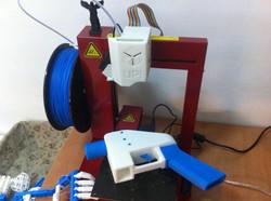 3D-printed gun and hand