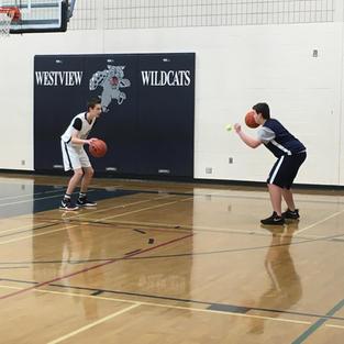 Junior Academy class working on ball handling with a partner.