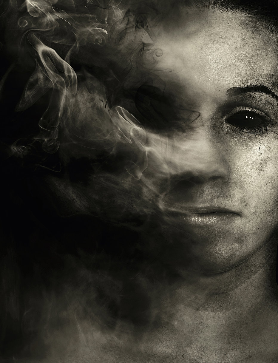a-womans-face-disappears-into-smoke_BioN